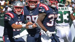 Damien Harris howls in elation after his 26-yard touchdown run in the third quarter, as Mac Jones (left) and Hunter Henry celebrate during the Patriots' 25-6 win.