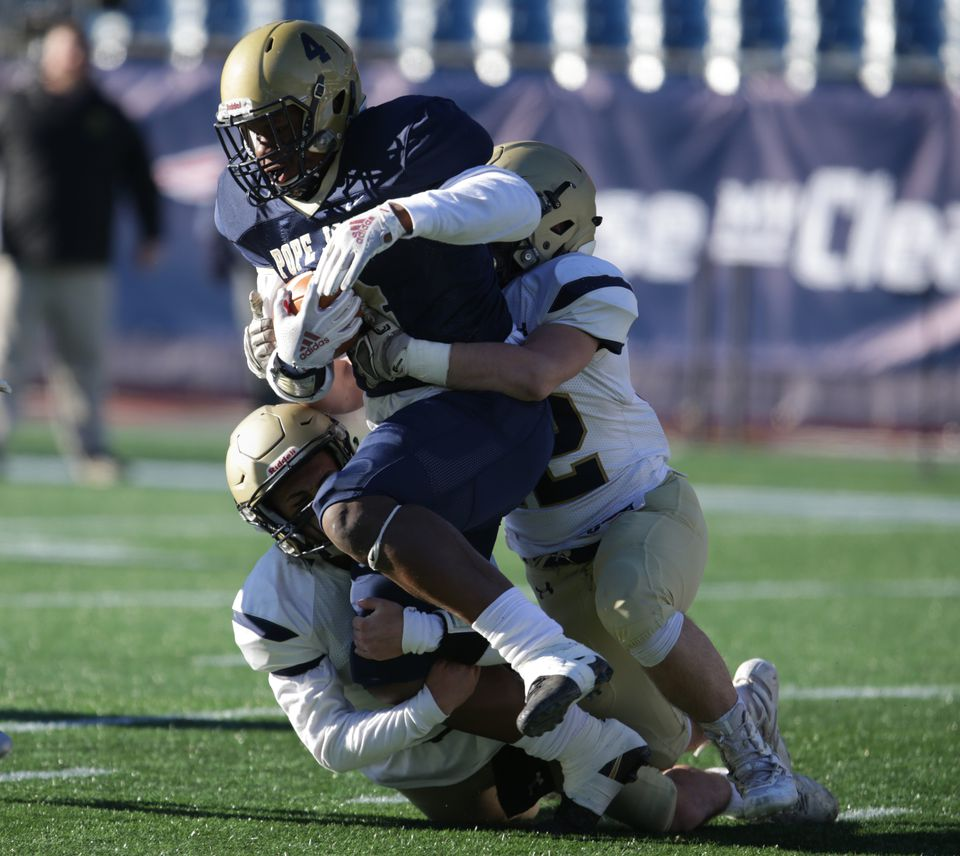 Pope John XXIII's Greg Smith is tackled during the MIAA Division 8 Super Bowl at Gillette Stadium.