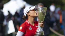 Australia's Minjee Lee kisses the Evian Championship trophy after defeating Jeongeun Lee6 on the first playoff hole.