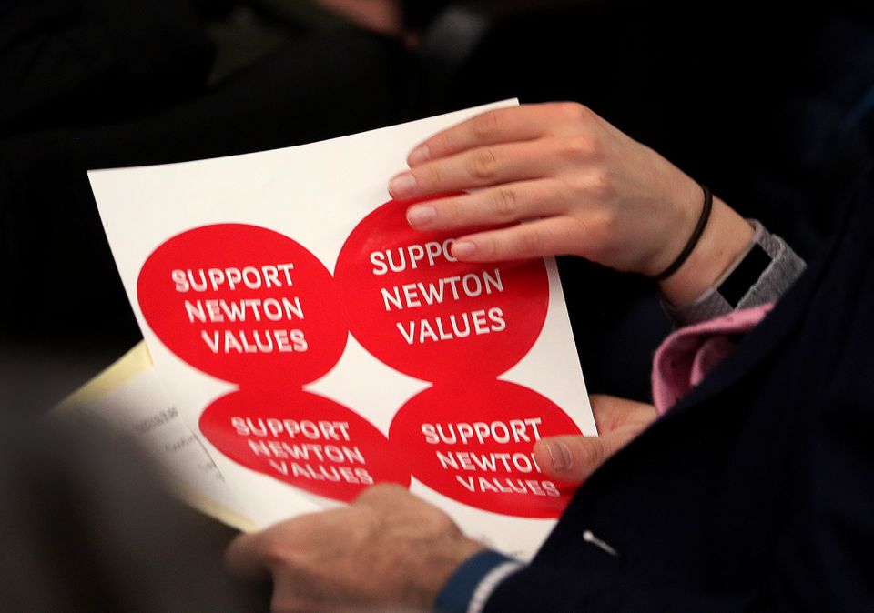Newton public school teachers protested during a public meeting last week.
