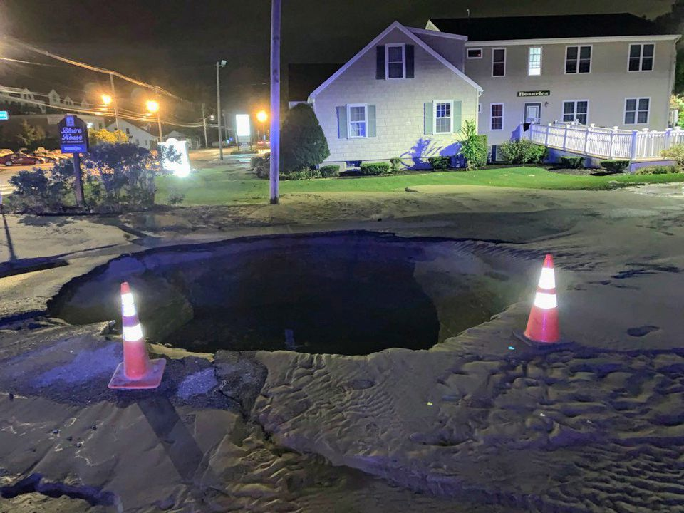 A water main break caused this hole in the ground in Tewkbury Wednesday morning.