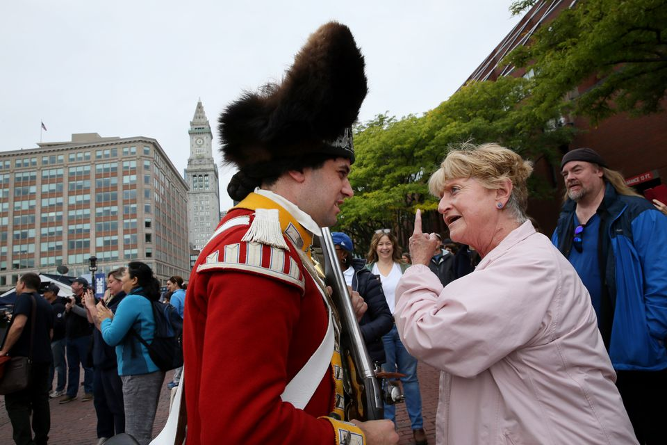 Reenactor Corp. Justin Murray exchanged opinions spectator Claire Coyle Aston.  In character, Murray claimed Boston is part on England, Aston firmly disagreed.