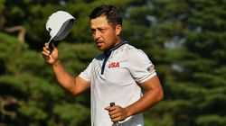 Xander Schauffele tips his cap after taking a one-shot lead into the final round of the Olympic golf.