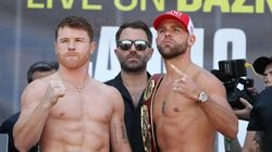 Promoter Eddie Hearn, center, believes Canelo Alvarez, left, and Billy Joe Saunders, right, will break the indoor boxing attendance record of 63,352.