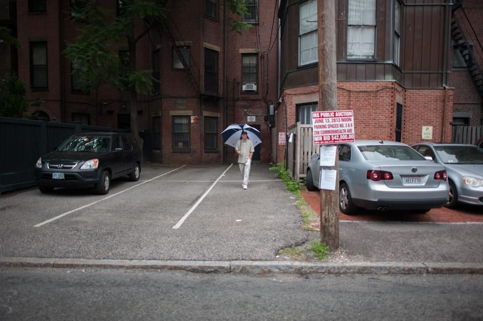 In 2013, a pair of tandem parking spaces behind 298 Commonwealth Ave. sold for $560,000.