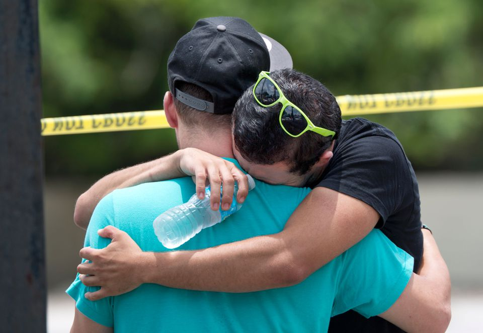 Supported by a friend, a man wept near the shooting scene.