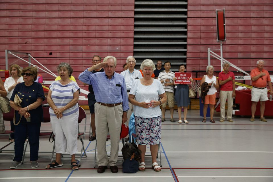 Donald Trump supporters stood for the national anthem during a campaign rally at Sacred Heart University in Fairfield, Conn., on Aug. 13.