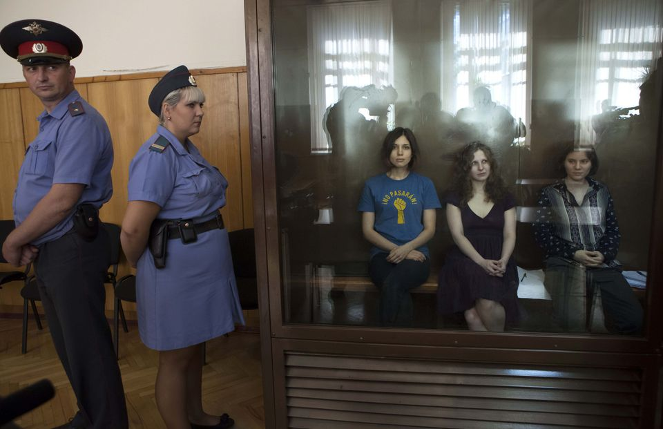 The members of Pussy Riot in a glass cage in a Moscow courtroom.