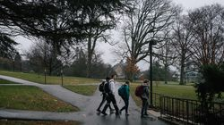 Students walk across the campus of Swarthmore College in Swarthmore, Pa., in this March 3, 2020, file photo.