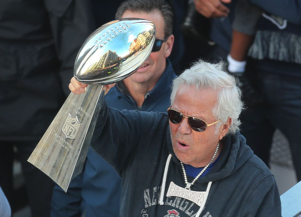 Patriots owner Robert Kraft had the bling in his hand and around his neck.