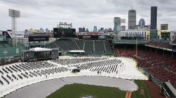 Students were spaced apart as they sit on the field at Fenway Park at Northeastern University's 2021 Commencement.