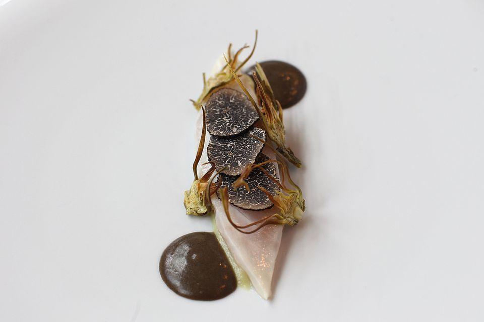 Sea bream over artichoke and mush-room purees, topped with artichoke crisps and shavings of truffle.