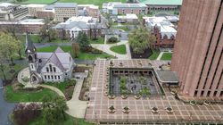 An arial view of the W. E. B. Du Bois Library at UMass Amherst. The school says 96.6 percent of its combined student, staff and faculty population of 29,300 is vaccinated.
