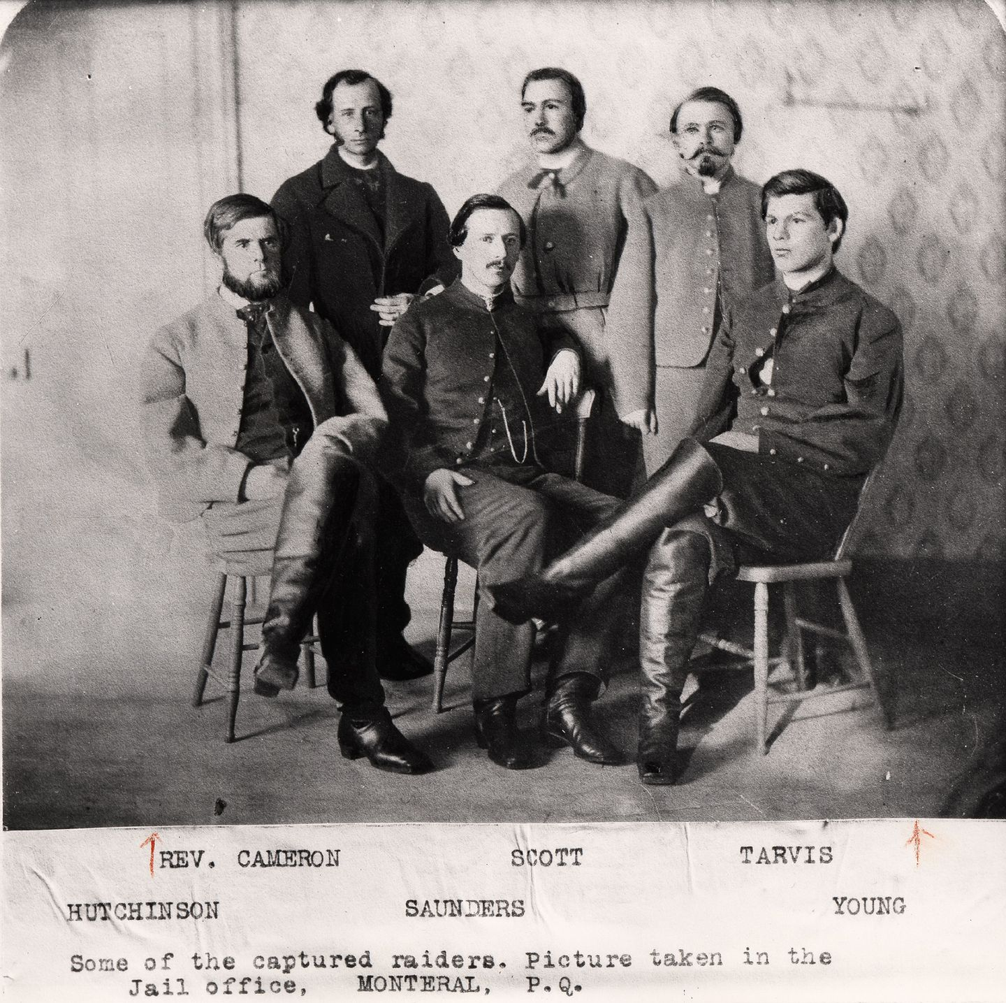 Lt. Bennett Young, seated at right, and several other               Confederates who raided St. Albans banks pose for a               photograph while awaiting trial in Canada. CREDIT: VERMONT               HISTORICAL SOCIETY (these images originally appeared in               Frank Leslie's magazine)