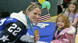 FILE - Olympic gold medalist Kacey Bellamy poses for a photo with Addie Raymond, 4, of Westfield during a meet and greet reception at the Boys & Girls Club of Greater Westfield, in Bellamy's hometown.