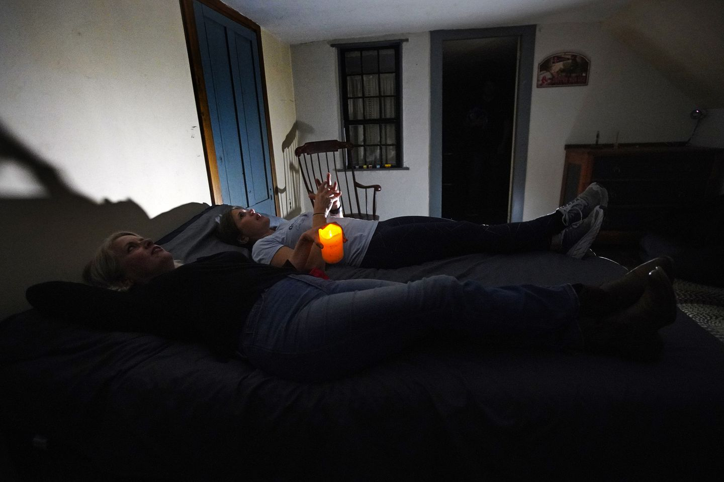 During the initial tour, visitors are encouraged to dim the lights and lie down on the bed in the house's center bedroom to get the best potential paranormal experience.