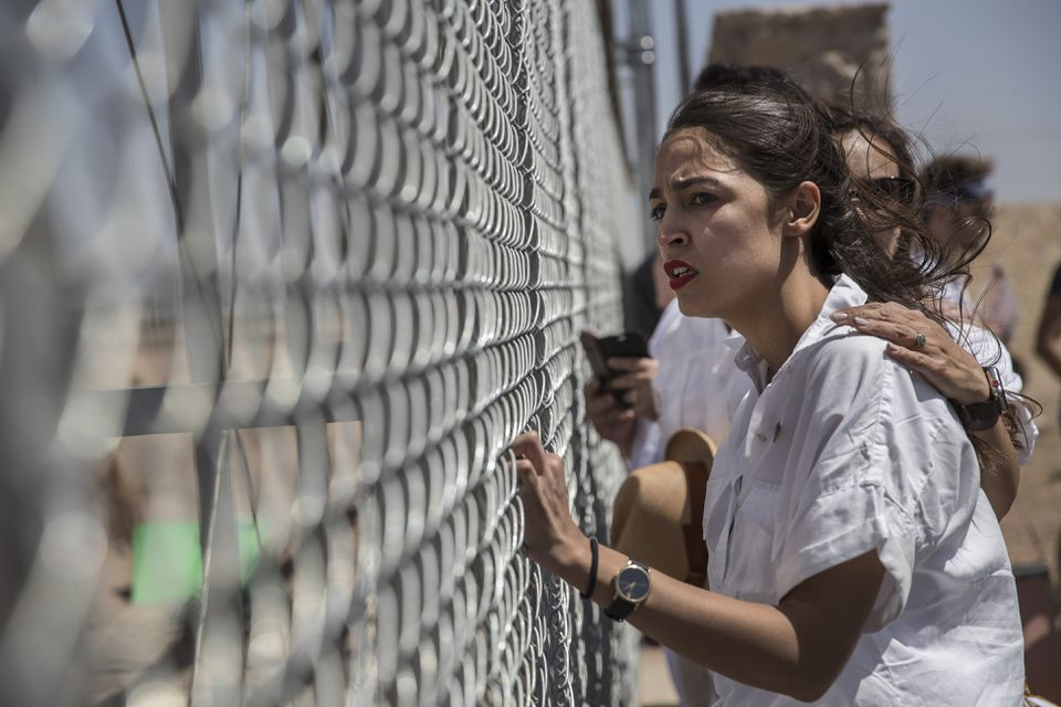 Alexandria Ocasio-Cortez and other demonstrators protested the immigration detention of children in Tornillo, Texas on June 23. Ocasio-Cortez, who won the Democratic primary in New York's 14th Congressional District on June 27, made abolishing Immigration and Customs Enforcement a central feature of her campaign.