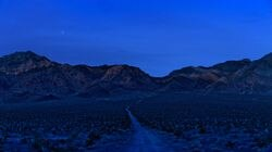 """From Sim Chi Yin's series """"Most People Were Silent"""": Mountain Range surrounding the Nevada Test Site, November 2017."""