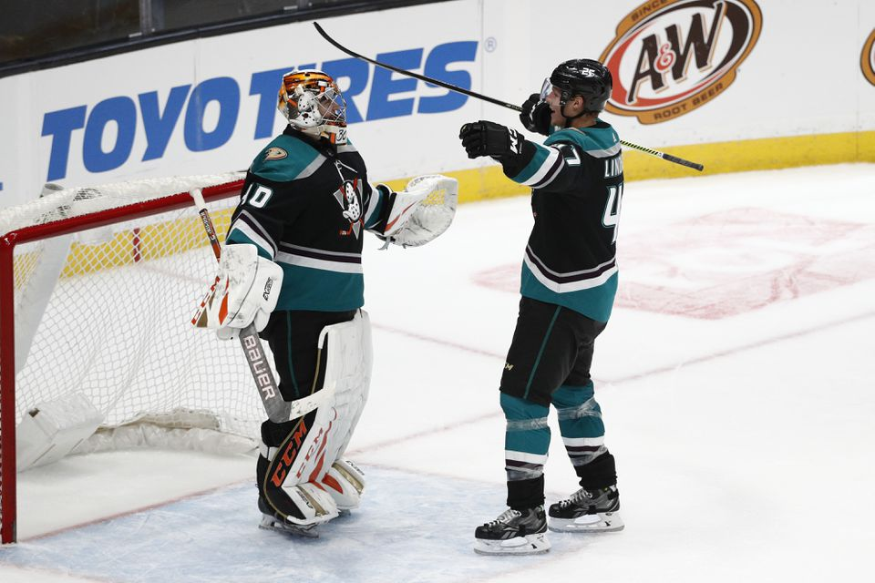 Ducks goaltender Kevin Boyle, left, who played at both UMass Amherst and UMass Lowell, was congratulated by Hampus Lindholm after shutting out the Canucks on Wednesday.