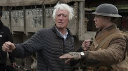 """Roger Deakins speaks with actor George MacKay on the set of """"1917."""" He won an best cinematography Oscar for the film."""