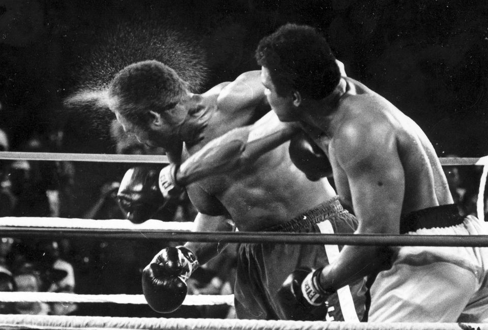 "George Foreman took a right to the head from Muhammad Ali in the seventh round of their ""Rumble in the Jungle"" in Kinshasa, Zaire, on Oct. 30, 1974."