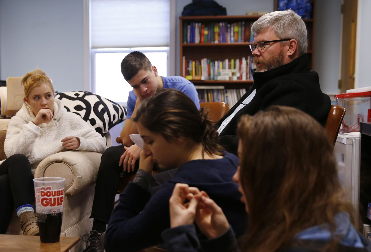 Jim Flanagan, the coordinator of youth ministries at St. Elizabeth Church, met with a group of students from the church to plan upcoming youth ministry events.