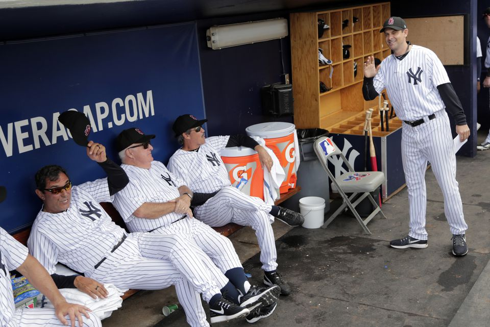 Aaron Boone (right) arrives in the dugout before a spring game last month.
