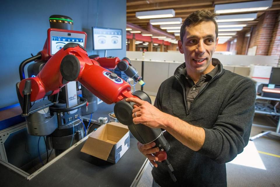 Robert White, principal mechanical engineer at Rethink Robotics, showed off Baxter, an industrial robot designed to work along with humans on production lines.