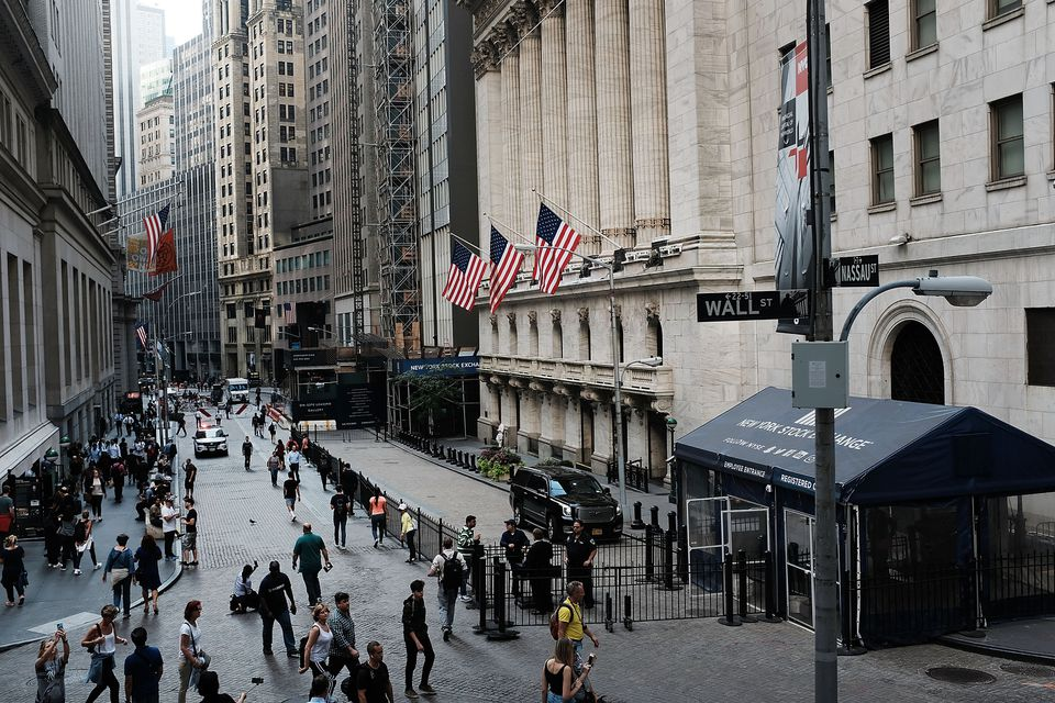 The Dow Jones Industrial Average lost more than 800 points Wednesday in its largest decline in eight months. The New York Stock Exchange is on the right.