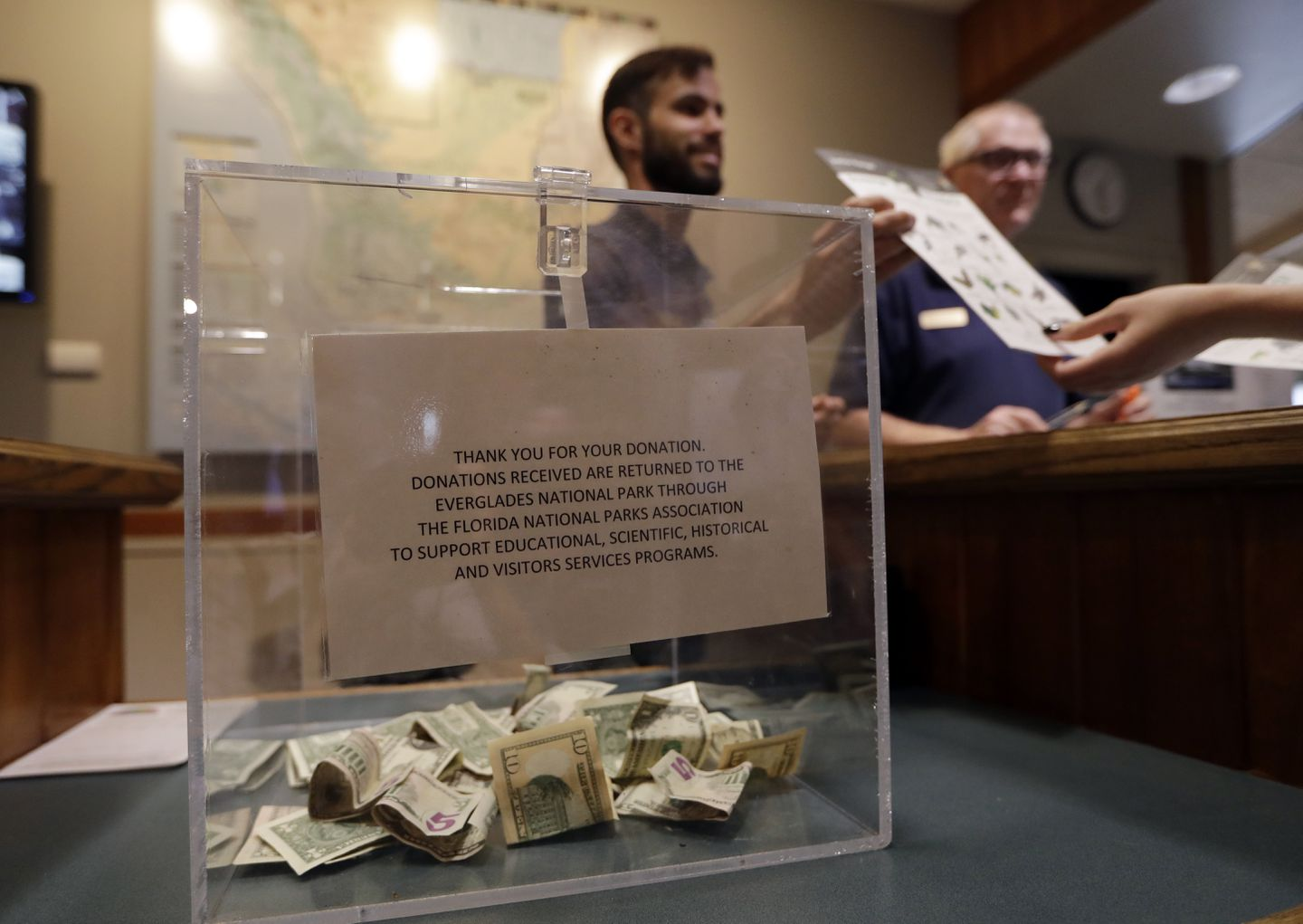 A donation box sat on the counter as Dany Garcia spoke with visitors at the Ernest F. Coe Visitor Center in Everglades National Park in Homestead, Fla.