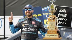 Martin Truex Jr. celebrates with his trophy in Victory Lane after winning the NASCAR Cup Series auto race Sunday at Darlington (S.C.) Raceway. It was his series-leading third win of the season.