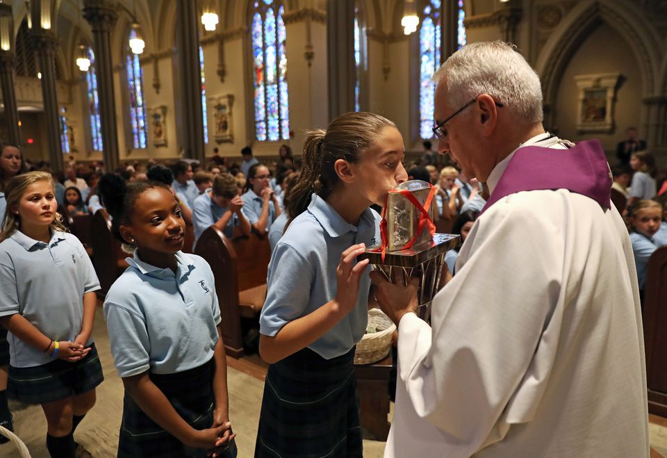 Students from Immaculate Conception School in Lowell lined up to venerate the heart of Padre Pio.