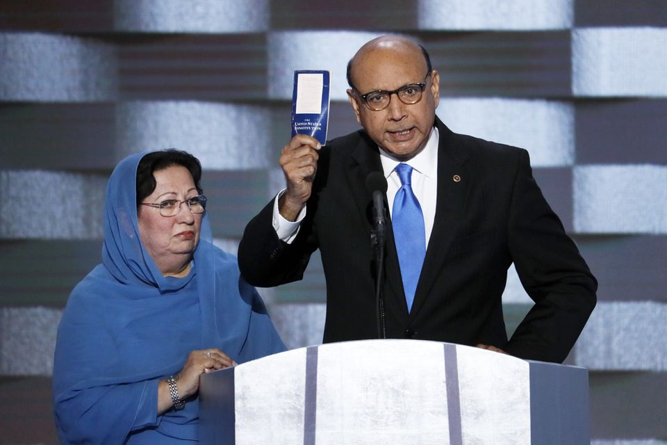 Khizr Khan, father of fallen US Army Capt. Humayun S. M. Khan held up a copy of the Constitution of the United States as his wife listened during the final day of the Democratic National Convention in Philadelphia in July 2016.