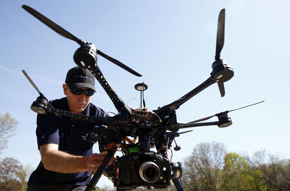 Matthew Murphy, president of Boston Virtual Imaging, prepared his drone for flight in Wellesley.
