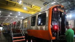 An MBTA employee checks on a new Orange Line train before a ribbon-cutting to celebrate the arrival of the trains in 2019.