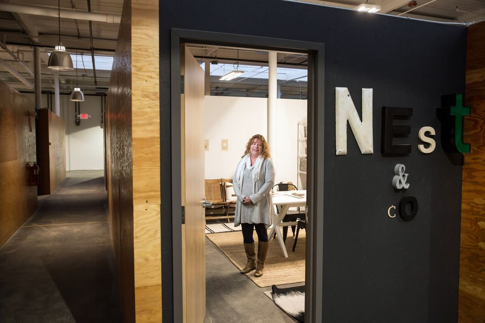 Interior designer Tracy Parkinson moved her Nest + Company office space from a loft building in Boston to the Norwood Space Center.