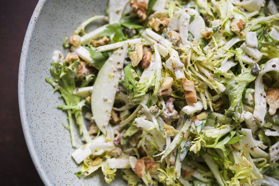Celery root and frisée salad with mustard and capers.