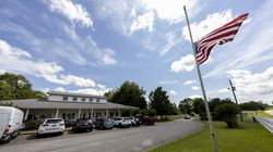 The US Flag flies at half mast Sunday, June 20, 2021, in Camp Hill, Ala., at the Alabama Sheriff's Girls Ranch which suffered a loss of life when their van was involved in a multiple vehicle accident Saturday, resulting in eight people in the van perishing.