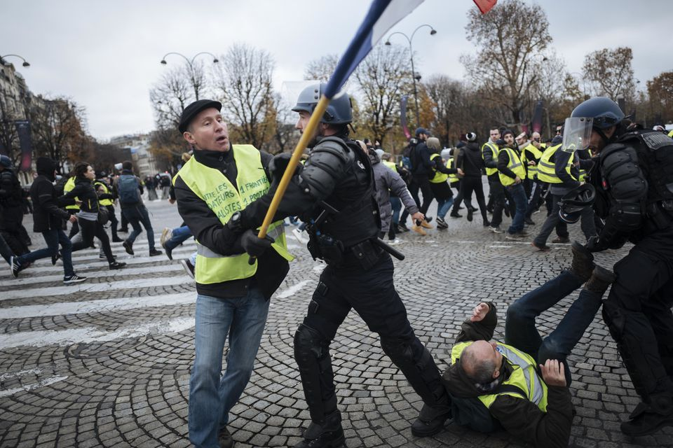 """On Nov. 24, Herve Ryssen, who had earlier been convicted of antisemitic and racist activity, clashed with police on the Champs-Elysees in Paris during a """"yellow vest"""" preotest."""