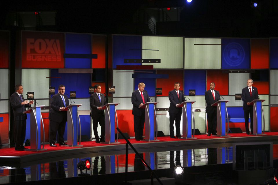 Governor John Kasich of Ohio (left) spoke during the Republican presidential primary debate.