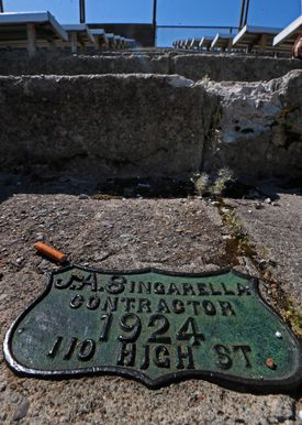 Stairs on the bleachers were crumbling, and a sign indicated they were built in 1924.