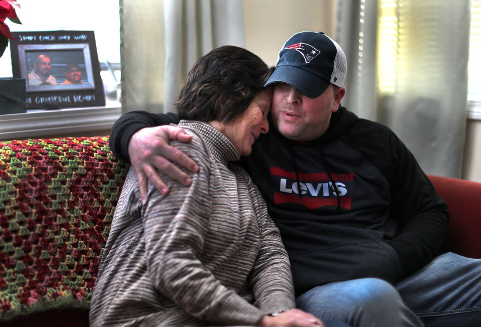 Anthony Perrotti (right) comforted his mother, Catherine Rawson, as she talked about the death of her son, Alan Greenough.