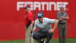 """""""Putter got hot there late on the back nine,"""" said Jim Knous, who lines up his putt on the 18th hole during round three of the Fortinet Championship."""
