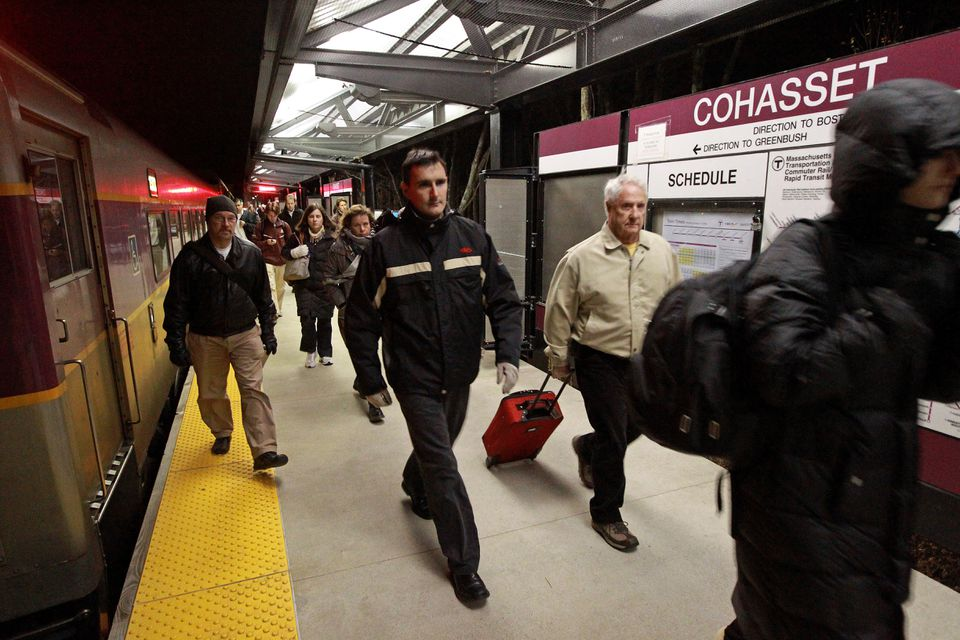 Passengers exited a train at the Cohasset stop on the Greenbush line. The line's cost ballooned from $252 million to $334 million by the time it opened in 2007.