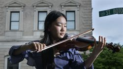 Keila Wakao, of Chestnut Hill, took top honors at the prestigious Menuhin Competition. She was photographed with her instrument this month outside New England Conservatory.