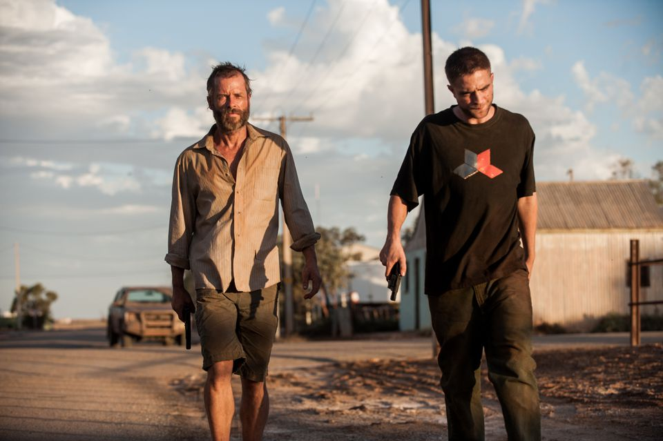 """Guy Pearce (left, with Robert Pattinson) plays a post-apocalyptic loner looking for the men who robbed him in """"The Rover."""""""