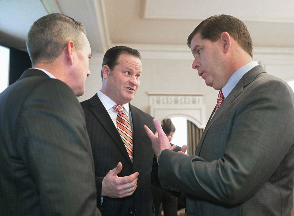 Bob Coughlin (center), president of the Massachusetts Biotechnology Council, chatted with Mayor Marty Walsh (right) and state Senator Michael Rush.