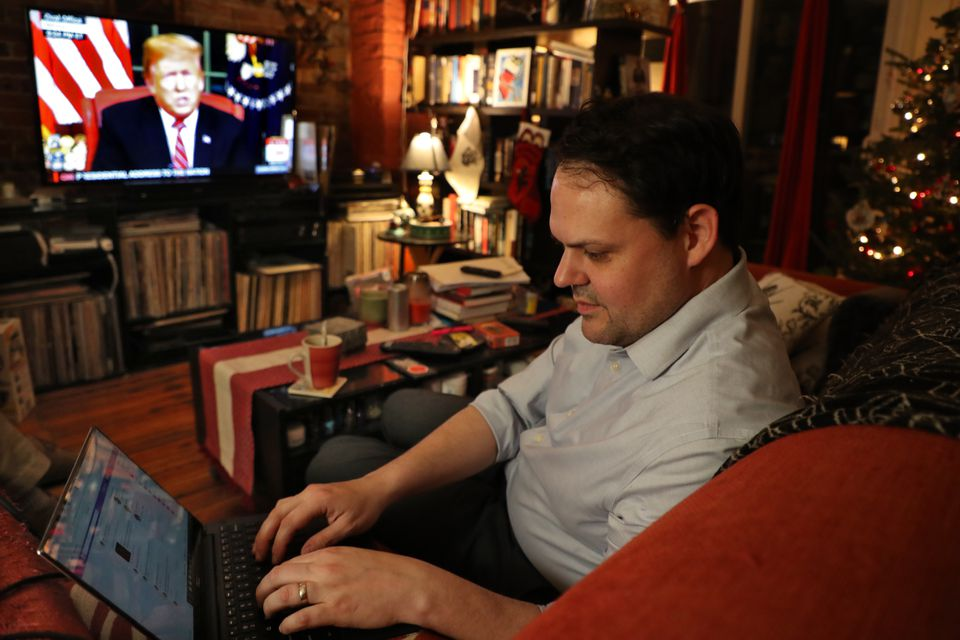 Matt Cameron, an Boston immigration lawyer, used Twitter and Facebook while he listened to President Trump's Oval Office speech Tuesday night.