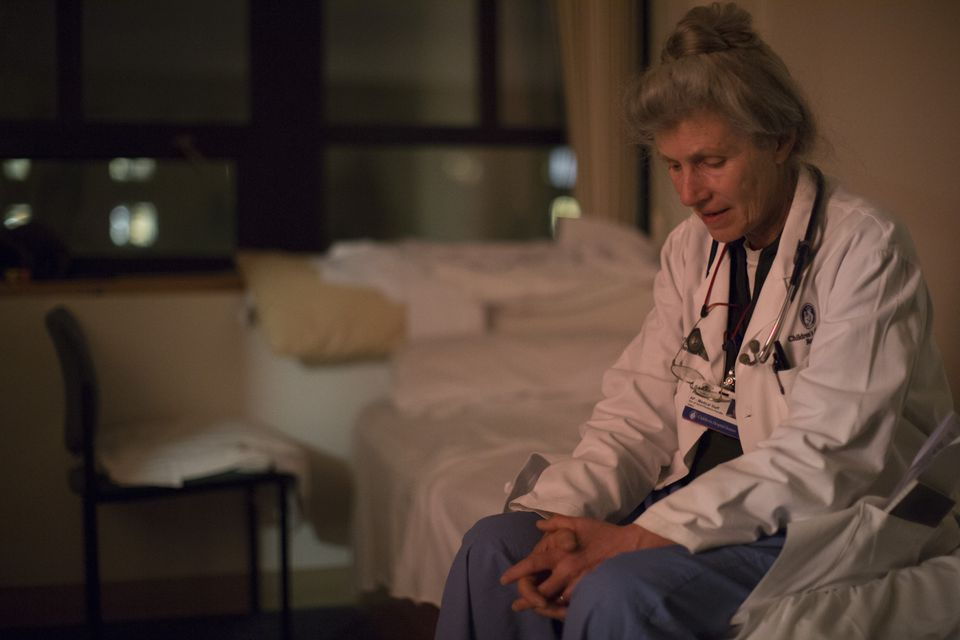 Dr. Henry is seen in a call room that is equipped with a small bed.