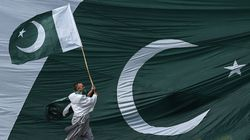 A man holds the national flag of Pakistan.
